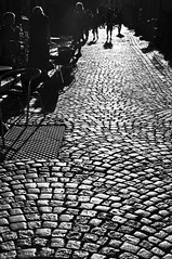 Stockholm's shadows (Paulina_77) Tags: street old city light shadow people urban blackandwhite bw sun sunlight white black brick monochrome backlight composition contrast dark point reflecting mono daylight town high cafe alley nikon key europe pattern boulevard afternoon view bright sweden stockholm outdoor pavement low bricks perspective creative sunny cobblestones pointofview stan sidewalk reflect walkway shade rush strong gamlastan backlit grayscale nikkor sunlit lowkey tones contrasts backlighting 18105 gamla szwecja d90 18105mm sverie nikond90 nikkor18105mm 18105mmf3556 nikkor18105mmf3556 pola77
