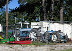 Ford Tractors And Agricultural Equipment. (dccradio) Tags: lumberton nc northcarolina robesoncounty stormdamage hurricane hurricanematthew matthew aftermath weatherrelated tree trees greenery storm damage ag agriculture agricultural farmmachinery ford tractors fence