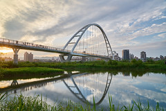Crescent Bridge (yiming1218) Tags:      crescent bridge architecture new taipei city taiwan banqiao reflection  sony gm g master 2470mm sel2470gm fe f28 ilce7rm2 a7r2 a7rm2 xin yue landscape sky skyline  sunset