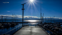 Sun On Leman Lake (Jean McLane) Tags: lac leman suisse bleu blue azul water waterfront port puerto sun reflects reflections reflejos reflets