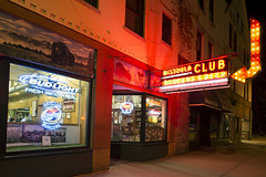 Missoula Club (Curtis Gregory Perry) Tags: missoula montana club night neon sign longexposure burger beer restaurant signage light sidewalk arrow bulb pabst bud budweiser miller alcohol hamburgers nikon d800e red mo moclub fresh smooth real mixed drinks