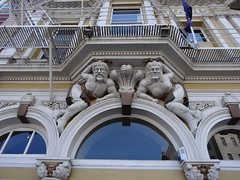 Dunedin. Greek gods as decoration above the front doors of Wains Hotel. Built 1883 as an expression of the wealth of the gold mining days of Otago. Architect Nathaniel Wales. (denisbin) Tags: dunedin wainshotel statues greekgods artdeco hihgstreet hilly