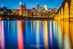 Down By The River (Greg Lundgren Photography) Tags: minneapolis skyline downtown urban cityscape onlyinmn meetminneapolis stonearchbridge mississippiriver reflection mirror night lights goldmedalflour guthrie wellsfargo capella ids skyscrapers twincities minnesota riverfront mainstreet gold arches yellow bluehour greglundgren millingdistrict jamesjhill midwest