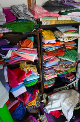 You See A Mess I See Possibilities - quilters stash (Kris_wl) Tags: closet busy patterns mess stash sewing quilting fabric bright colors color