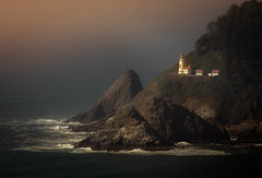 Evening Light on the Lighthouse - Florence, Oregon (Bryan Harding - Outside the Box Design Studio) Tags: oregon oregoncoast pacificocean pacificcoasthighway lighthouse light waves rocks ocean water sea pacific pacificnorthwest northwest cliff forest coastline heceta hecetahead florence statepark