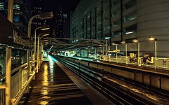 Waiting (Migltellez) Tags: exploring buildings rainynight rainy wet trainstation chicago waiting urban city lonely perspective gloomy lights night dark elevatedtrain traintracks