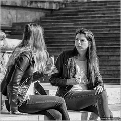How is yours? (John Riper) Tags: johnriper street photography straatfotografie square vierkant bw black white zwartwit mono monochrome hungary budapest candid john riper fujifilm fuji xt1 18135 young women girls students snacking cookie serious stairs statue monument