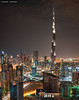 Giant (DanielKHC) Tags: panorama vertical night digital bay long exposure dubai cityscape uae business khalifa dri hdr burj blending d300 danielcheong danielkhc sigma50mmf14 vertorama
