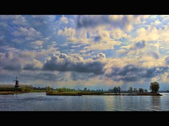 A favorite river view (Wim Koopman) Tags: trees light sky holland mill water netherlands windmill dutch clouds canon reflections river photography photo mood stock nederland atmosphere delta powershot rhine rijn stockphoto s90 waal merwede stockphotography s100 gorinchem wpk s95 esturarium
