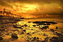 Golden Time (khalid almasoud) Tags: city winter sunset sea beach clouds canon eos golden evening photo rocks flickr all photographer place time tide low  rights estrellas kuwait 2009 khalid reserved formations march31     greatphotographers 50d  photographyrocks almasoud flickraward  thebestofday gnneniyisi greaterphotographers
