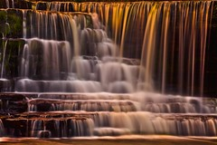 Liquid Gold - Aysgarth Falls at Sunset (Steve Thompson images) Tags: longexposure sunset england water river landscape waterfall nationalpark yorkshire hdr northyorkshire yorkshiredales aysgarth wensleydale aysgarthfalls ndfilter middlefalls polarisingfilter riverure canon70200llens canon5dmark2 aysgarthmiddlefalls