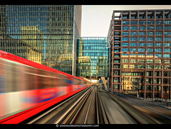 DLR Train to Canary Wharf (Edwinjones) Tags: street uk windows england urban color colour reflection london glass architecture modern train reflections lights office colours britain sony sigma rail canarywharf dlr heronquays