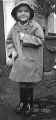 Bank Holiday Monday (theirhistory) Tags: girl hat mac child boots coat flowerpot raincoat wellies souwester