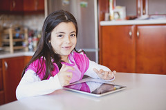 Portrait of a small girl using a tablet (Nasos Zovoilis) Tags: life family boy portrait brown white playing reflection cute love home apple beautiful face childhood mobile fun toy happy kid eyes toddler europe child play hand phone looking little sweet head expression room father small joy young adorable handsome son athens read communication greece sofa parent health blond attractive worry inside charming care tablet hold iphone