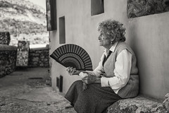 Fanning (Brian Hammonds) Tags: street old travel light shadow espaa woman white black color tourism lady contrast photography fan photo spain nikon europe european image picture eu tourist spanish local traveling cuenca espaol resident d600