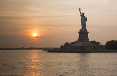 Liberty Sunset (Photosequence) Tags: street new city nyc newyorkcity bridge sunset usa newyork reflection water statue skyline brooklyn canon river liberty reflex downtown cityscape unitedstates manhattan nj uptown timessquare brooklynbridge eastriver jersey newyorkskyline hudson gotham northeast bigapple eastcoast libertystatepark sund northjersey theatredistrict