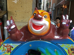 Monster Doing Air Quotes (cowyeow) Tags: amusementpark ride rides child fun evil weird ugly twisted disturbing vivid character characters bad badart funny funnychina shenzhen asia asian guangdong wrong china chinese strange  classic animals cartoon cartoons statue store storefront bear street composition art scary