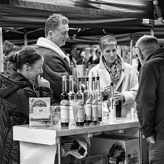 The Wine Tasters (Geoff France) Tags: mono monochrome blackandwhite street streetphotography urban lowry salford salfordquays people outdoor market streetmarket