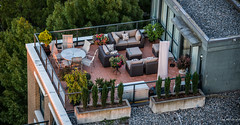 2016 - Vancouver - Roof Top Patio 2 of 2 (Ted's photos - Returns late November) Tags: 2016 bc cropped nikon nikond750 nikonfx tedmcgrath tedsphotos vancouver vancouverbc vancouvercity vignetting slippers roof tiledroof railing railings gravel seating seats table chairs planter emptyseats planters brick pavers pillows sofa cans2s shadow shadows roundtable tabletop