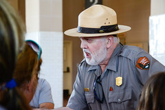 MircK - Ranger Doug at Ellis Island (imNOTaPh) Tags: sheriff ellis nikon d3100 usanationalpark newyork mirck ontheroad roadtrip holiday beard ellisisland cap police immigration americandream