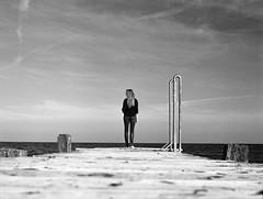 Malin (Juliet Alpha November) Tags: ilford delta 100 analogue analog film rollfilm medium format mittelformat 120 645 sw bw outdoor portrait portrt bridge steg baltic sea ostsee fehmarn fehmarnbelt beltretter jan meifert