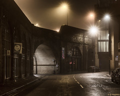 Foggy Start (whistlingtent) Tags: newcastle upon tyne westgate road fog mist arch bridge brickwork let sign signposts light burst white lines windows curves straight sinister spooky lights north east england urban