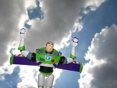 Buzz flying (Street Image Photography 365) Tags: sky sun clouds canon project buzz creativity toys photography fly cowboy funny toystory buzzlightyear flash flight creative woody disney pixar imagination 365 strobe strobist revoltech