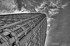 Playing Hide And Seek With The Sun (DetroitDerek Photography ( ALL RIGHTS RESERVED )) Tags: sky urban blackandwhite bw usa game detail building monochrome up june architecture clouds digital america canon midwest downtown view angle michigan detroit hideandseek 5d hdr allrightsreserved 2012 mkii 313 motown motorcity 3exp crookedonpurpose ihaveacolorversionofthisoneimaypostatsometime
