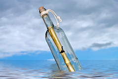 message in a bottle (Francis Jimnez Meca) Tags: ocean sea summer sunlight seaweed beach nature wet water glass sunshine mystery neck paper bottle sand weed glow message stuck natural buried unique ripple cork sandy debris shoreline note coastal shore edge bubble letter gleam seashore find bubbly shimmer intrigue messageinabottle uniqueness