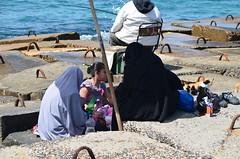 Alexandria Picnic (npangere) Tags: sea women rocks picnic mediterranean egypt egyptian fortress qaitbay