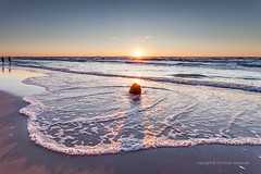 sunset (PeterJot) Tags: travel blue sunset shadow sea sky people orange sun beach nature landscape outdoors sand europe wave poland balticsea baltic foam flare trunk seafoam seawater