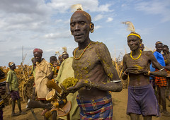 Dassanech Tribe People Putting Cow Dungs On Their Bodies For A Ceremony, Omorate, Omo Valley, Ethiopia (Eric Lafforgue) Tags: africa men strange horizontal outdoors weird funny day african ceremony tribal celebration omovalley tradition ethiopia tribe dung frontview hornofafrica thiopien etiopia etiopa blackskin smallgroupofpeople  omorate etiopija colourimage ethiopi geleb  dassanech etiopien etipia  etiyopya  snnpr southernethiopia merille truepeople    dassanetch omotic   daasanach daasanech dassanach    ethiopianethnicity ethiopianomovalley omo137988