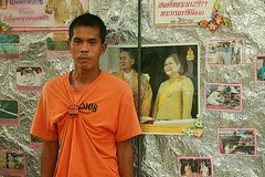 showing his loyalty to the king (the foreign photographer - ) Tags: man orange shirt king queen showing loyalty khlong thanon portraits bangkhen bangkok thailand canon kiss 400d