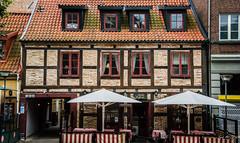 2016 - Baltic Cruise - Helsingborg Sweden - Olsons Skafferi (Ted's photos - For Me & You) Tags: 2016 cropped nikon nikond750 nikonfx sweden tedmcgrath tedsphotos vignetting olsonsskafferi olsonsskafferihelsingborg helsingborgsweden helsingborg cafe umbrellas streetscene street seating windows patio