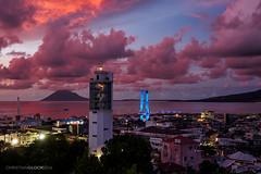 Soekarno bridge sunset (Christian Gloor (mostly) underwater photographer) Tags: soekarno bridge manado sunset red orange blue cityscape sulawesi indonesia olympus omd em5