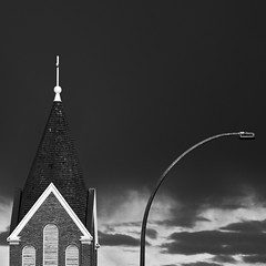 Shape Opposition (Mister Day) Tags: steeple church opposites rain moody architecture abstract shapes geometric lines shadows light dynamic opposed edmonton alberta skies cloudy brick roof metal pole