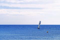 En Mditerrane (Fnikos) Tags: blue sea seascape water sky skyline mediterranean serene boat sailboat vehicle outdoor