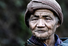 a line for every year (Rajiv Lather) Tags: camera portrait people india mountains face closeup canon beard bhutan image grunge royal streetphotography kingdom tribal photograph age experience knowledge wisdom wrinkles himalayas thimphu tribesman flickrstruereflection1 hillyregion