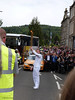 Displaying the torch at North Inch (P&KC Archive) Tags: sport fun photography scotland community perthshire streetscene celebration 20thcentury relay olympicflame torchrelay localhistory olympictorch torchbearers historicevent civicpride perthandkinross ecsochistory recordinghistory