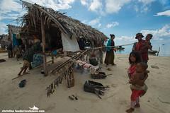 drying seafood - Ligitan Island, Sabah, Malaysia-1 (Christian Loader) Tags: family baby house home girl island child native hut malaysia seafood local sabah seagypsies seagypsy bajau bajaulaut ligitan scubazoo christianloader ligitanisland scubazooimages