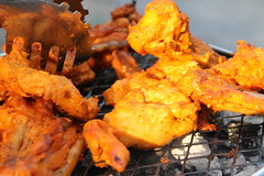 Barbecued chicken (WorldClick) Tags: red summer food orange green chicken vegetables yellow canon eos photo yummy wings flickr photographer seasons purple legs smoke tomatoes spice pomegranate tasty bbq onions flame worldwide photograph peppers onion taste spicy kebabs barbecued phototgraphy chapal 1100d canoneos1100d worldclick
