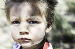 sandy face (Lara Cores) Tags: blue portrait face up 50mm kid eyes child close sweet candid sandy laracores