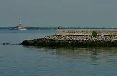 Within Reach (MPnormaleye) Tags: urban sculpture water beautiful america 35mm liberty island harbor waterfront manhattan statues utata vista historical monuments majestic memorials