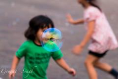 Bubbles (gauravs82) Tags: reflection kids ball children fun toy soap air bubbles running warp blow sphere burst activity playful