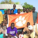 "Brad Gregory '83 and the hospital staff in the village of Werkok in the Republic of South Sudan show off a Tiger Paw flag donated by a member of the University's athletic department for the children's soccer team — known as the Werkok Tigers • <a style=""font-size:0.8em;"" href=""http://www.flickr.com/photos/49650603@N07/9730312165/"" target=""_blank"">View on Flickr</a>"