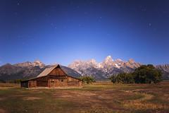 Moulton Barn at Night (Geoff  RT Ficiel ) Tags: wood longexposure trees sky usa mountains night barn stars landscape nikon peak beam moonlight wyoming grandteton moultonbarn mormonbarn 35mmf2afd d700