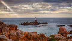 Corbierre Lighthouse and a Sunray (Nigel Jones LRPS) Tags: light red sea lighthouse danger rocks beam jersey granite shipwrecks channelislands corbierre