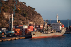 In Port (stevef325) Tags: ocean light sea port island evening ship crane cargo delivery caribbean tanker containers select
