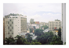 013_21 (jimbonzo079) Tags: above hhi hotel urban city vintage old life window asia utm15 utm work art view trip travel 2015 world color colour kolkata india earth west bengal sky green tree palm building hindusthan international outdoor architecture cloud film negative 35mm scan analog mood canon ae1 fd 50mm f18 lens slr portra 160 new kodak portra160 newportra160 kodakportra160 newkodakportra160