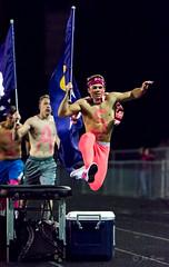 High school football: flag runner hurdles (rikki480) Tags: cheerleader guy spirit hurdle run flag jump chest paint touchdown celebration highschool football game outdoor sport bishop dwenger fortwayne indiana field stadium
